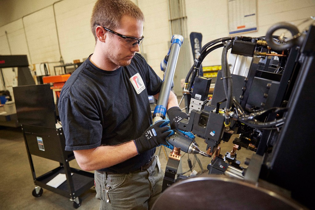 Certified technician working on Lincoln Electric equipment