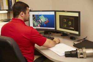 Engineer using CAD modeling software