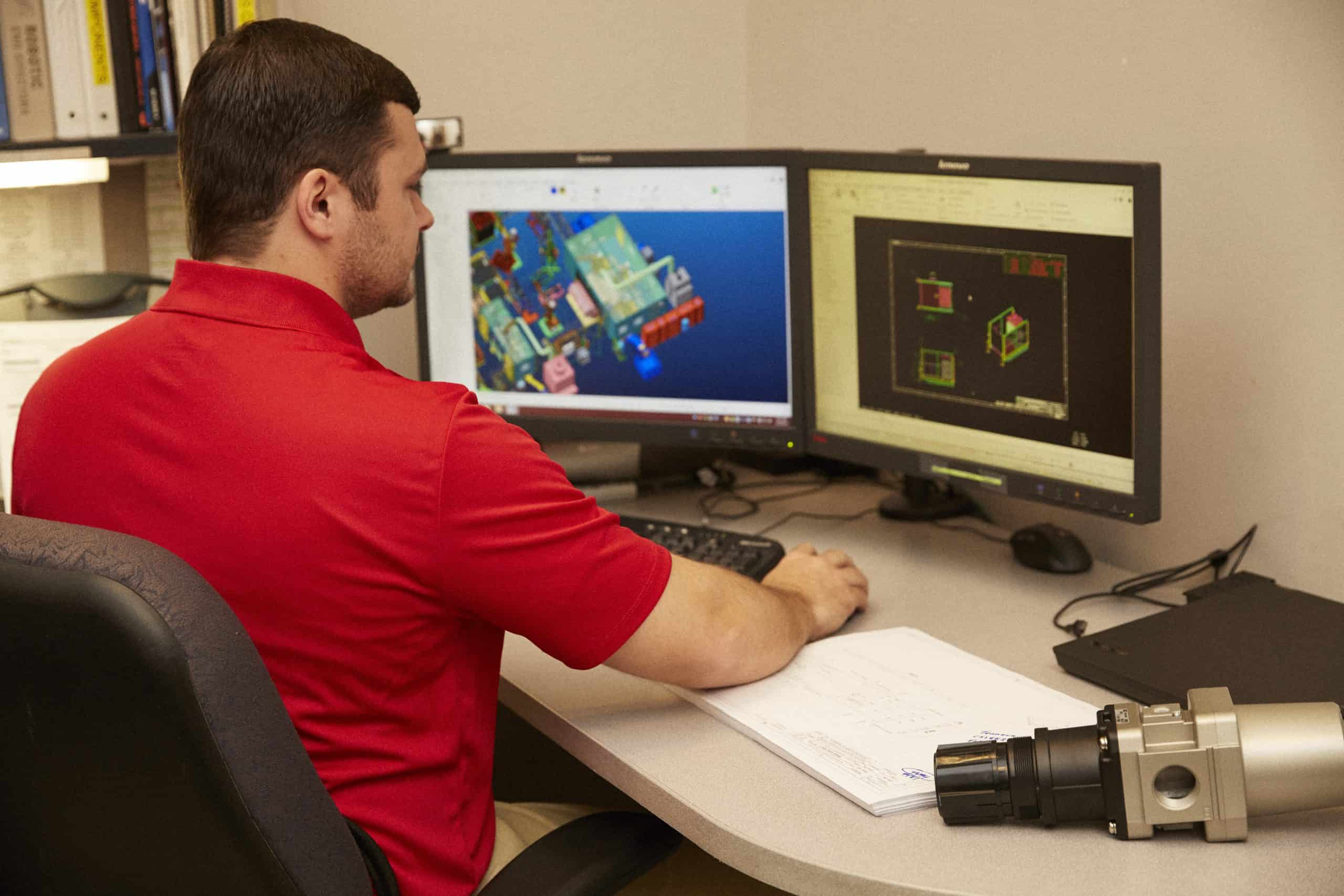 Engineer using CAD modeling software